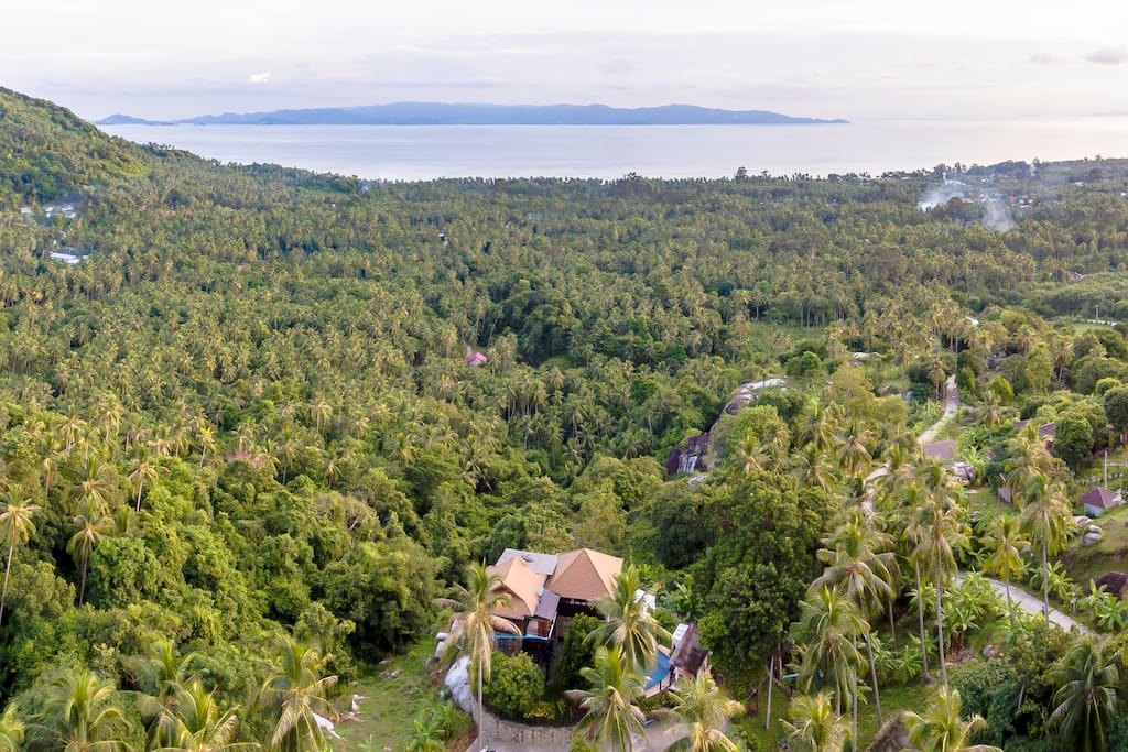 The villa view from the sky facing the jungle with a panoramic 360 view on the sea and Koh Samui.
