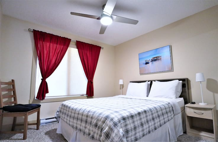A view of the secondary room. Featuring a good stock of linens and the high quality ceiling fan.