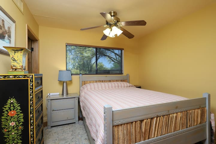 The bedroom is directly off of the living/kitchen area, and it comfortably fits a queen-sized bed.
