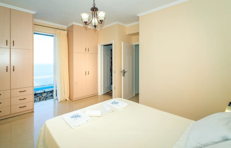 Ground floor double bedroom with en-suite and direct access to the pool area.