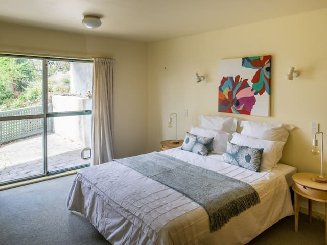 Room 1 with King Bed and private courtyard.