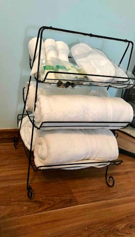 All linens, toiletries and slippers are available to you.  Forget toiletries ... we have extra.