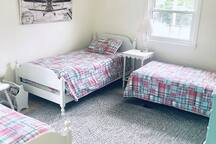 Kids bedroom with 3 twin beds and TV