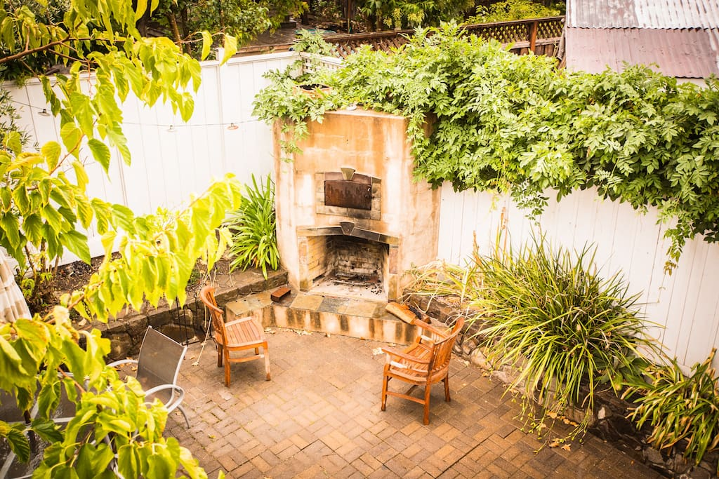 Back yard with Pizza Fire oven. Perfect place to mingle.  Backyard could be shared with other guests.