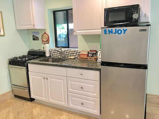 Brand new kitchen with stainless steel appliances and granite countertops.