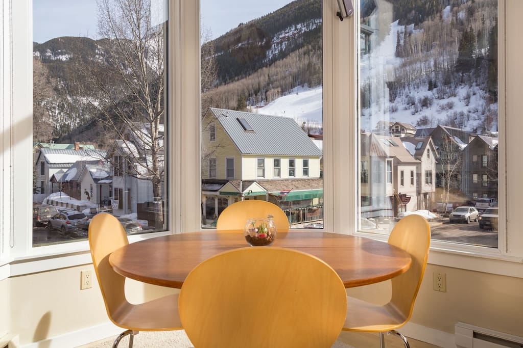Bright and sunny dining area with views of the gondola and ski runs