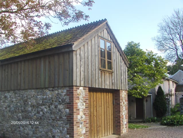 Studio flat above stone outbuilding