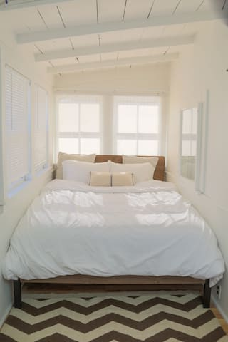 A comfortable queen-sized bed with brand new mattress and linens.