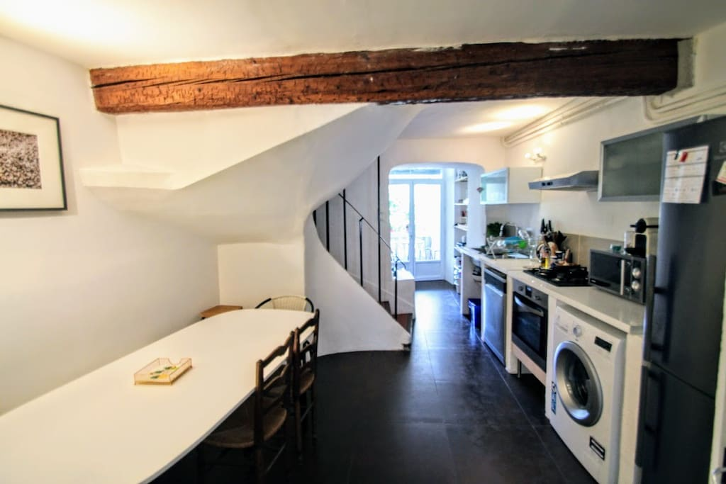Fully equipped dining area and kitchen with dishwasher, fridge and freezer, oven, microwave, nespresso machine, drip coffee maker, and kettle. Access to laundry area with washer and dryer.