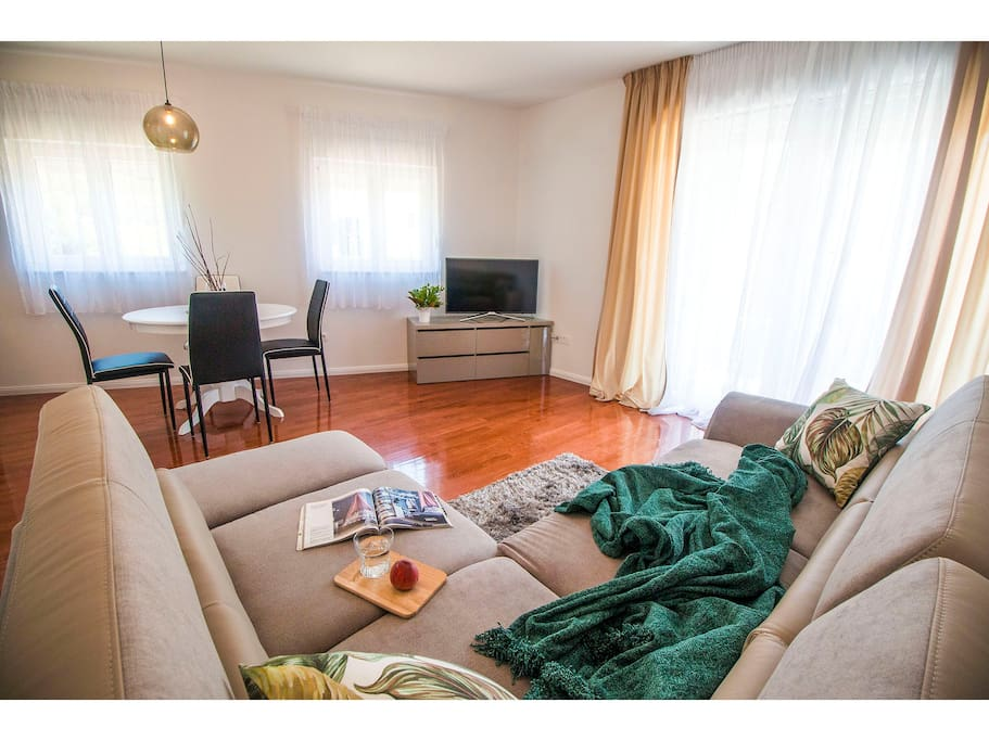 Living & dining area with sofa bed,  Smart TV with Android, Hi fi, satellite programs,air conditioning , fully equipped kitchen and exit to  the balcony