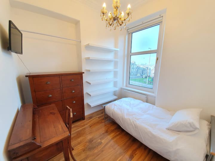 Bright single room in charming granite house.