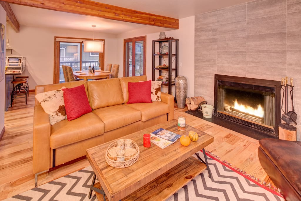 Living Room – plenty of comfortable seating, large flatscreen TV and fireplace.  The perfect place to unwind with friends/ family after an active day!