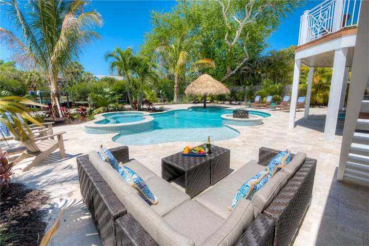 Serenity Beach - Lovely and spacious 5 bed/4.5 bath canal front home with private pool and spa!