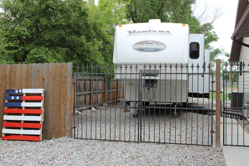 Roomy 5th wheel in fenced yard. Parking available directly in front of 5th wheel.