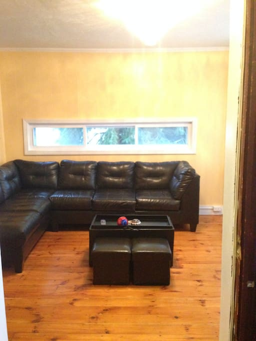 Very comfortable living room to relax in.  A fifth person can easily sleep on this very comfortable sectional.