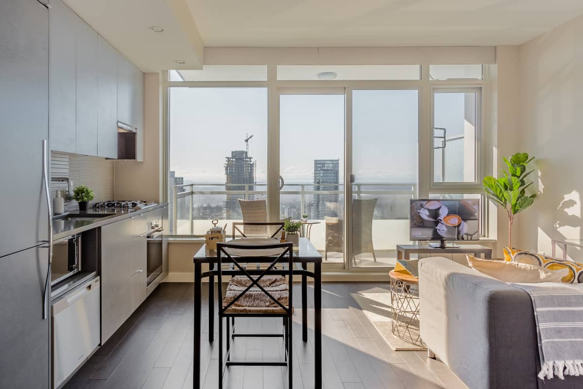 Witness Breathtaking Sunsets from a High-Rise Studio Balcony