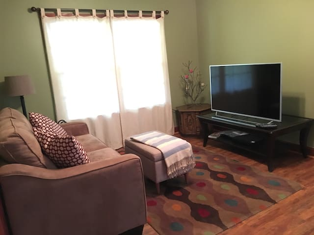 Comfortable den with satellite TV, a DVD player and assorted movies to choose from.