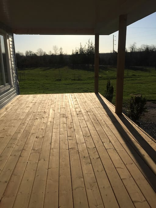 View from the 10' x 50' front porch complete with 2 oversized rocking chairs and separate seating area.