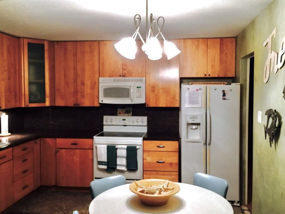 Spacious, well stocked eat in kitchen with custom maple cabinets, granite counter tops and brand new appliances