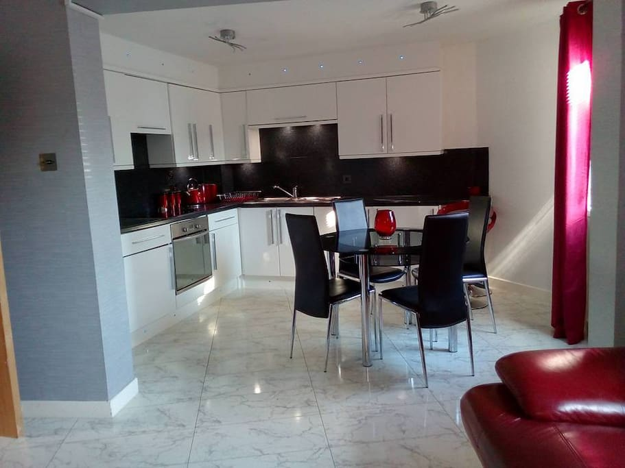 Modern kitchen with integrated appliances - oven, washing machine, fridge, dishwasher, microwave
