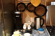 Coffee Station for your convenience. We supply coffee pods, sugar cream and tea. Enjoy!
