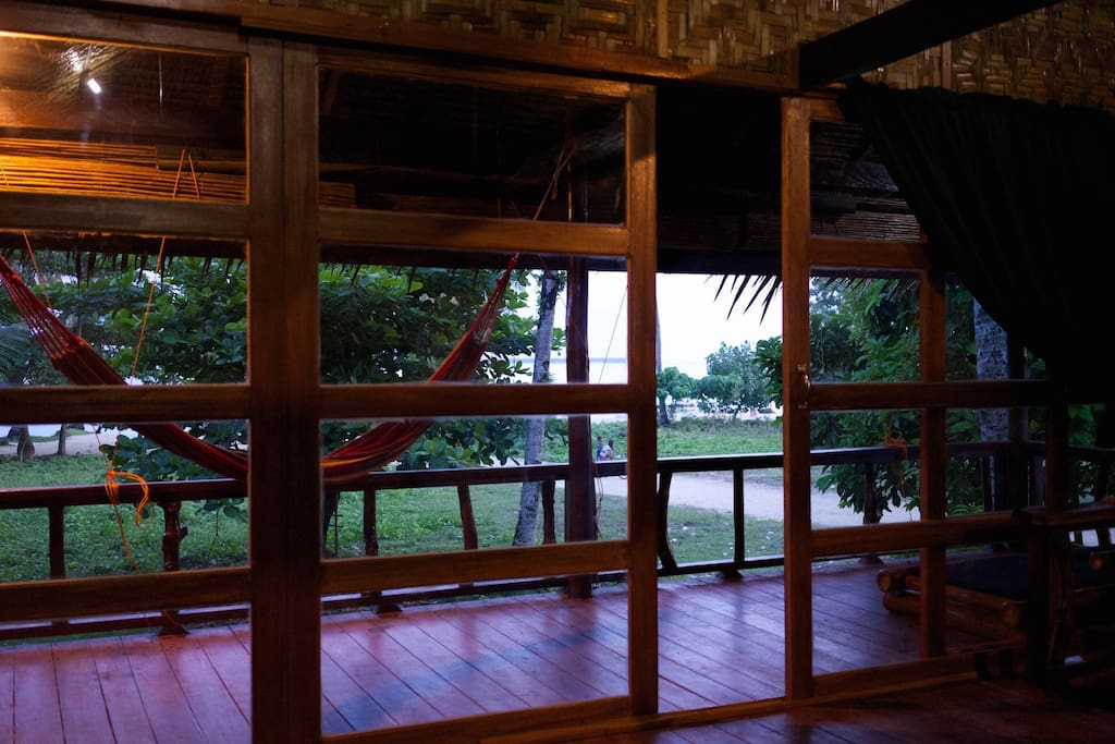 Interior view out through the sliding door towards the beach