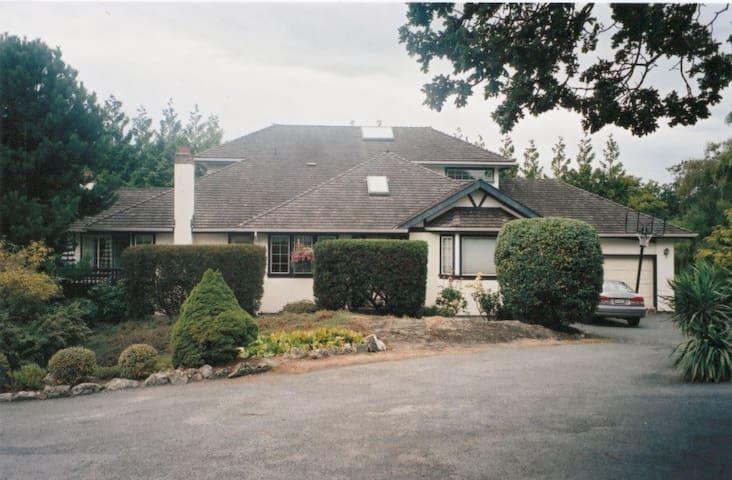 Modern Oak Bay home set amongst heritage mansions.