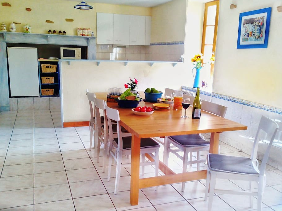 The open plan dining area/kitchen of Villa Hibiscus is bright and airy.