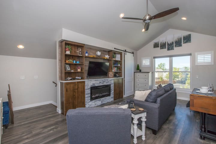 As you come up the stairs you will see a large flat screen TV above the electric fireplace. Great for cuddling up on a cold night and watching Netflix, Prime videos, or one of the several movie provided.