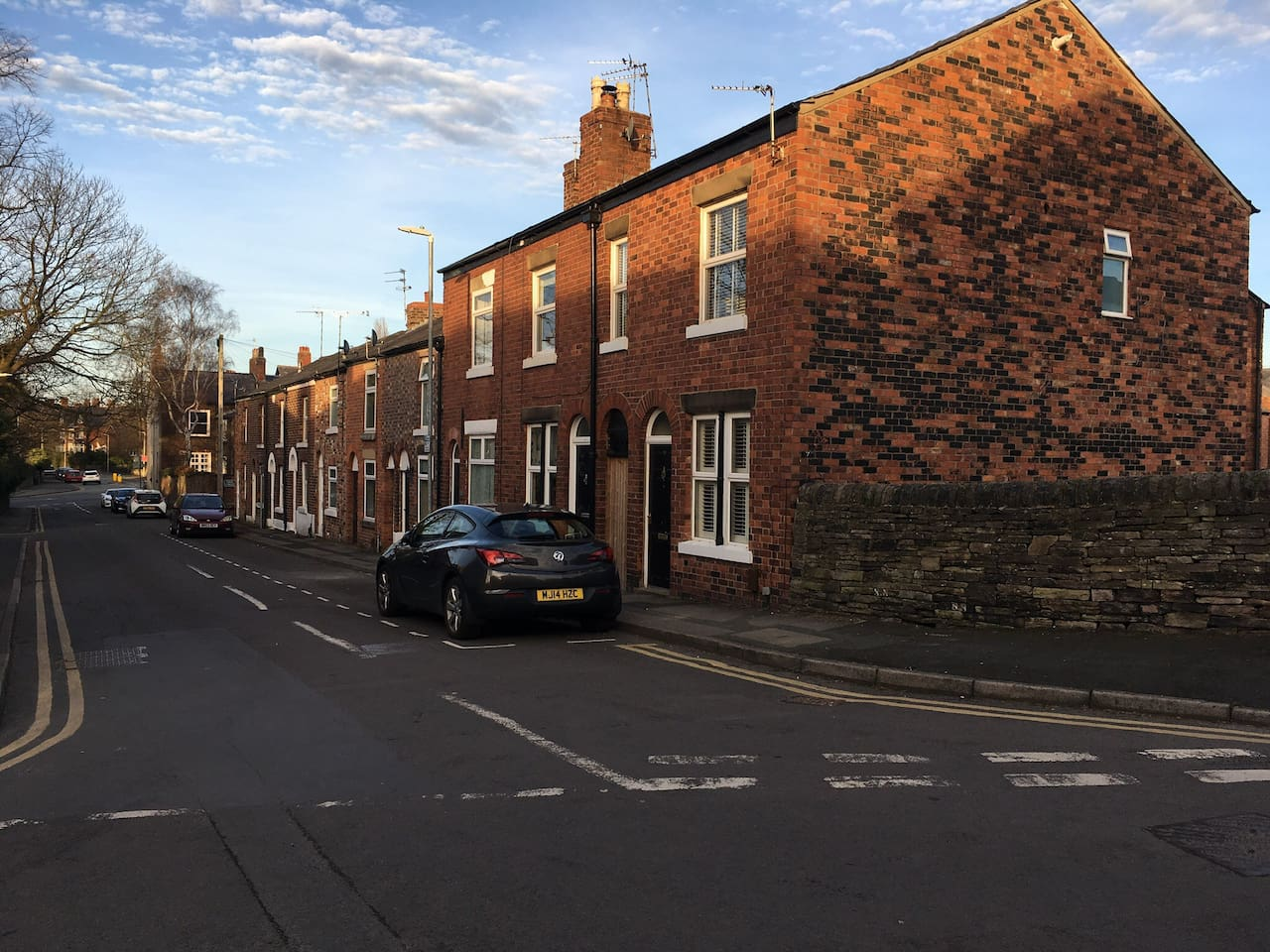 The house (end terrace nearest to camera) is on a quiet, pleasant street