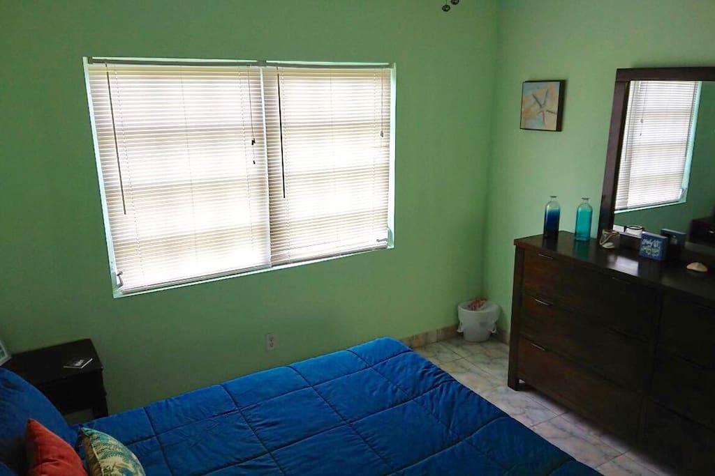 Bedroom 1. Queen sized bed with plenty of dresser space.