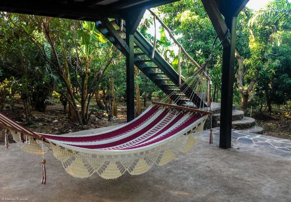 Large hammock for relaxing on the first floor open-air platform