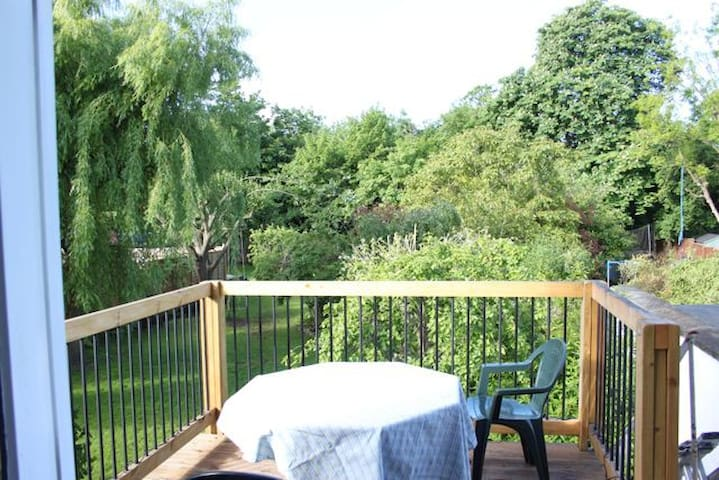 First floor south-facing deck overlooking the garden. A lovely spot for a sunny breakfast or a mellow evening sunset.