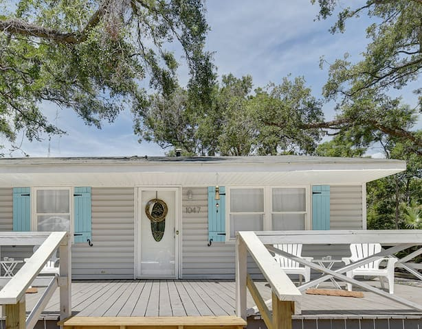 Large front porch with Adirondack chairs faces a quiet 1940's era neighborhood street - enjoy a cup of coffee and say hello to neighbors out for a bike ride or walk to the beach.