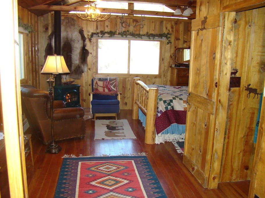 Master Bedroom with comfortable sitting space and wood stove.