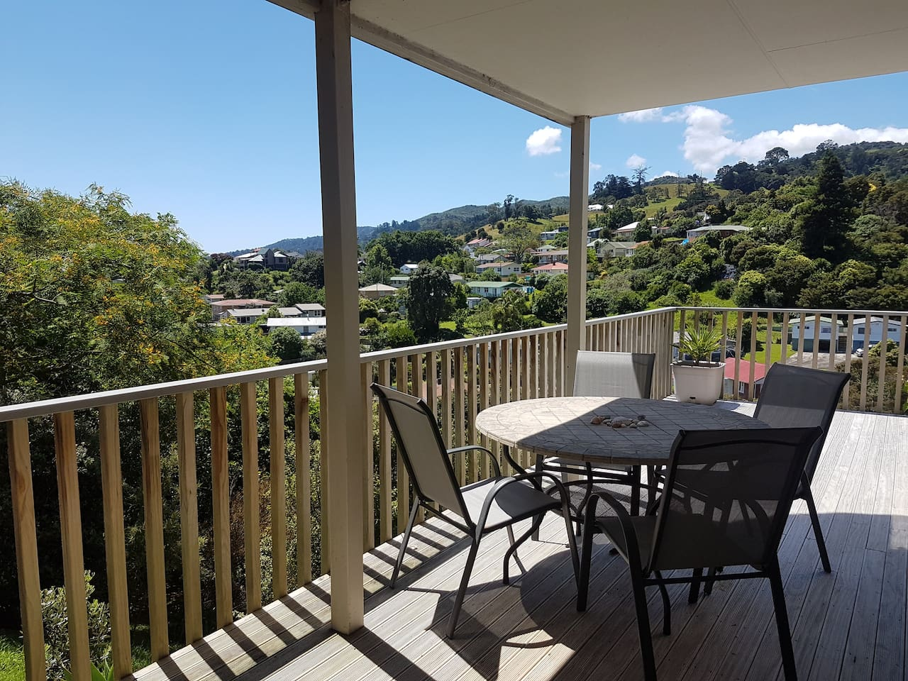 Your private deck with relaxing views over hills, town and sea.