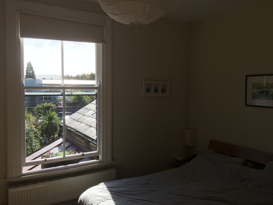 Upstairs Bedroom 1. Double bed with memory foam mattress topper. Super quiet and bright with views of the Dublin Mountains. Newly insulated and reglazed windows means quiet and warm.