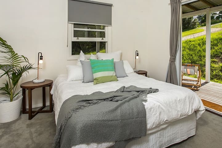 Bedroom 1 - Queen Bed with ceiling fan. Enjoy a peaceful stay with cool breezes