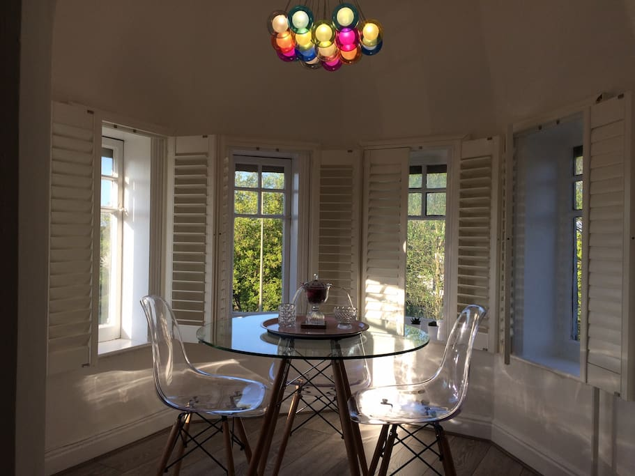 Bright Turreted Dinning area with Semi-Panoramic views.