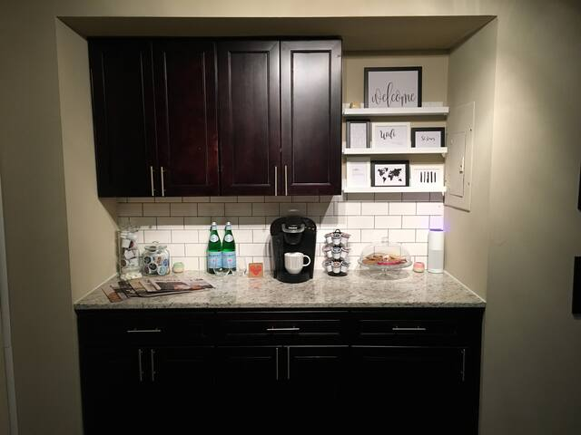 This is the coffee bar in the living area, there is a Keurig with complimentary tea, coffee and hot cocoa as well as an Amazon Echo for your convenience.