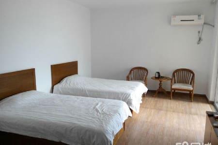 1602曦岛假日湾旅游度假一线海景公寓 - Yantai - Appartement