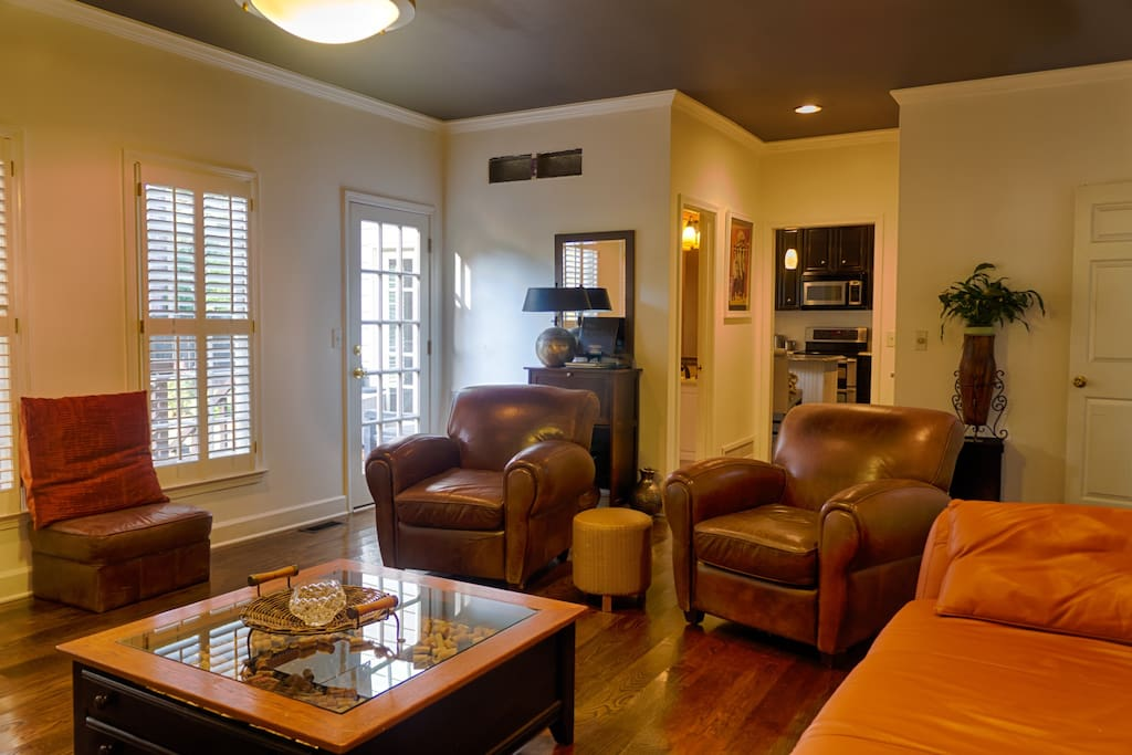 Family room extends to eat-in kitchen and French door to upper outside deck.