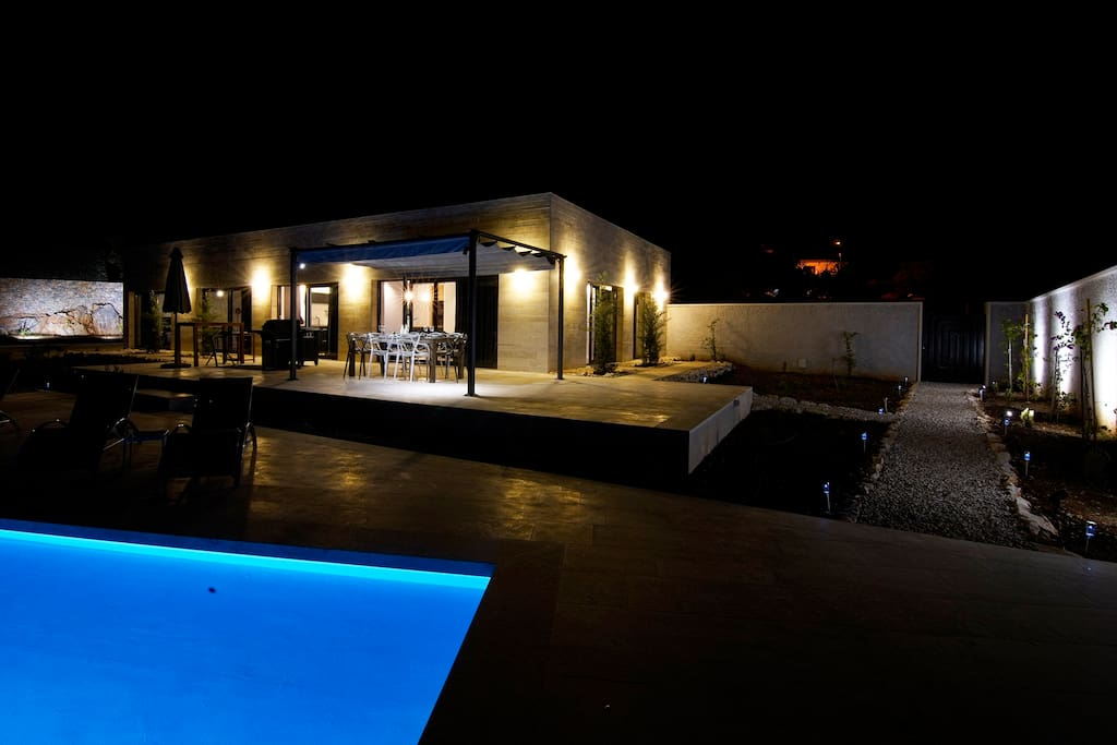 Exterior with swimming pool by night
