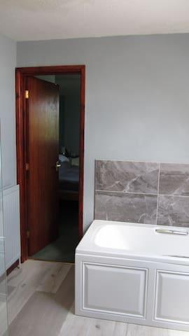 From en suite bathroom into bedroom.