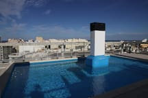 Piscina con espléndidas vistas del Grao, el Puerto, la Playa y las Montañas