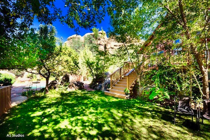 Take a stroll and relax on the lawn of the Cliff Chalet adjacent to the Cave Castle,  only 100 yards away. Do you see the blue glint of a pool below the chair on the left? If it's fruit season, feel free to pick a few peaches, pears, plums or apples.