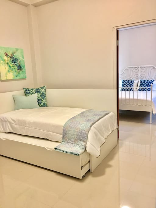 Room 2; Private room with Two Twin size beds with trundle. A/C blackouts. A plus Door can be locked or left open as adjoining room. ( good when traveling with children. )