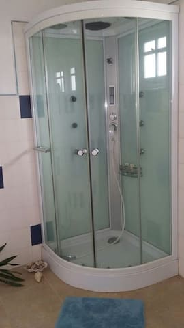 Modern bathroom shower with hot water