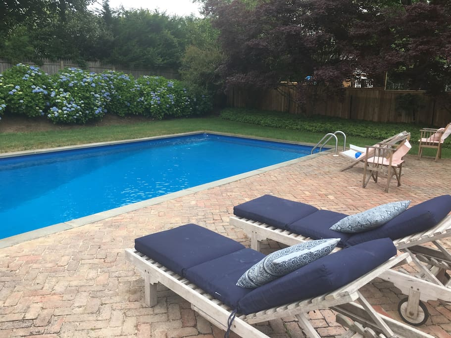 Heated pool surrounded by hydrangeas