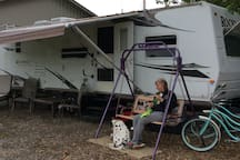 Front view of RV, come enjoy a relaxing swing and throw the dogs ball until your arm falls off. Lol